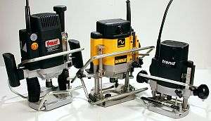 What to look for in a router table part two wealden tool online photo 5 shows three models fitted with plungebars one of them the dw 625 also has the router raizer fitted greentooth Choice Image
